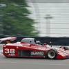 """""""After the SCCA scrapped the Single-Seat Can-Am in 1986, there was one last attempt to bring life back to the Can-Am concept. In 1989, Carrol Shelby joined with the SCCA to design and develop a 'Shelby Can-Am' to be used in SCCA amateur and professional racing. This would be a 'spec formula' in that the cars would only race against each other and was intended to build on the success of the Sports Renault (now Spec Racer Ford) that had been running very successfully in SCCA racing since 1984.<br /> <br /> The Shelby Can-Am used a 3.3-litre Dodge V6 engine and a single-seater chassis with sports car bodywork - although the front wheels were not covered. Two prototypes were built in 1989 and a series of cars were put into production by Racefab Inc in Texas for 1990. The cars were very strong; designed to be safe but also robust enough to survive many seasons of racing. The SCCA did not recognise Shelby Can-Am as a class in 1990 because there were too few cars but it was given a demonstration event at the 1990 Run-Offs and became a SCCA class for 1991. A 'Pro' series also started in 1991 and was tied that first season by ex-Formula Atlantic driver Scott Harrington and Campbell Soup heir Bennett Dorrance. The other champions over the next five years were Kyle Konzer, Gene Harrington, Mike Davies (twice) and Jerry Gilles. David Tenney won the amateur crown at the Run-Offs in 1991 and 1992, then Davies won for the next three years before Jeffrey Tyler won in 1996. Shelby Can-Am was then dropped by the SCCA.<br /> <br /> However, this category refused to die. A total of 76 cars had been built and now had nowhere to run so 28 of them were bought up and shipped to South Africa to create a new spec series there. These raced from 2000 onwards as Vodacom Sports Prototypes although the ageing Dodge engines were replaced by 3.5-litre Nissan VQ35 V6 engines for the 2002 season. For the 2005 season, the series returned to the Shelby Can-Am name and Vodacom dropped their support at t"""